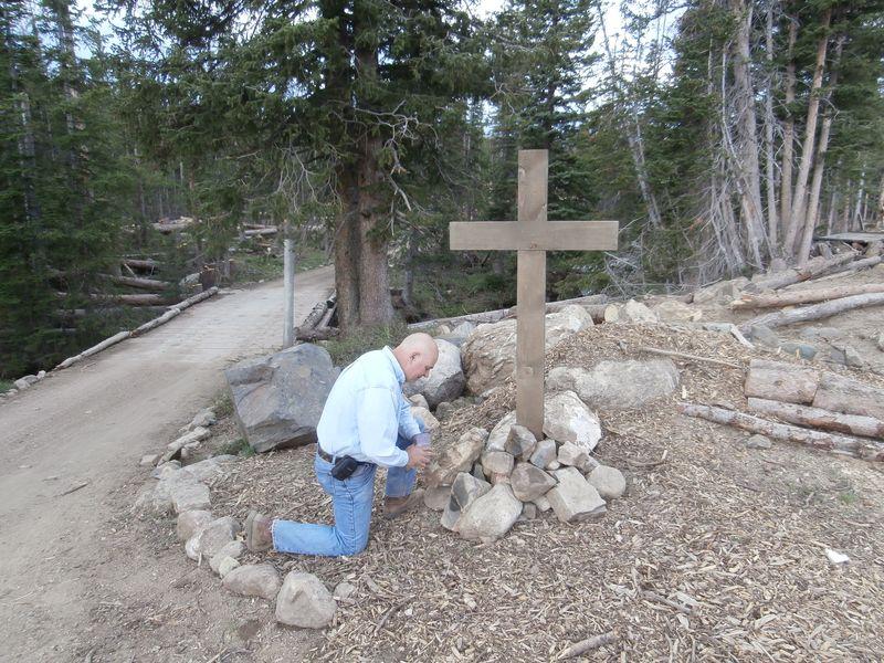 Scotty Kneel at the Cross
